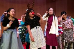 Third graders performing in chapel